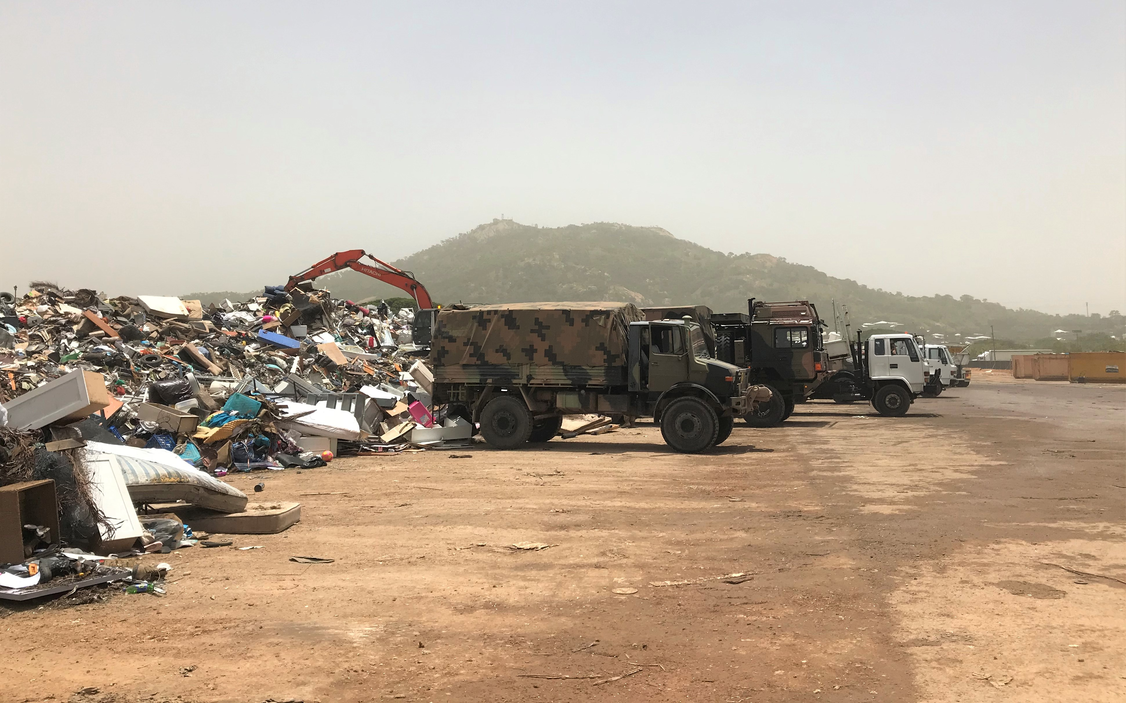 Photograph of army trucks clearing flood debris in Townsville, 2019. CC BY 4.0 Patrick White.